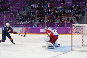Team USA's T.J. Oshie scores the game winning goal over Russia during a shootout in their men's preliminary round hockey game at the Sochi 2014 Winter Olympic Games