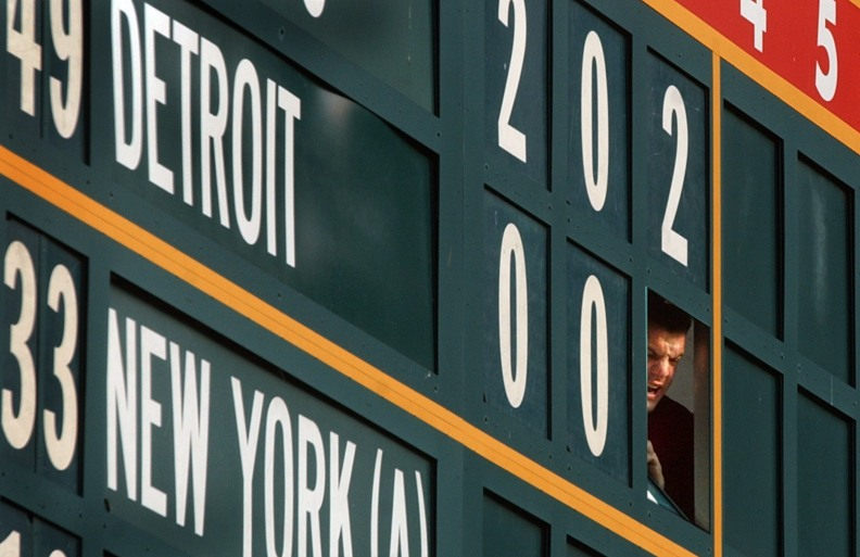 (Phil Carlson) With the Detroit Tigers unwittingly lending a hand, manual scoreboard operator Danny Buffa playfully heckles one of the ushers working below during the Cardinals-Giants game Wednesday night at Busch Stadium.